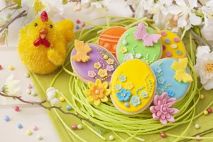 Colorful easter cookies on a wooden background
