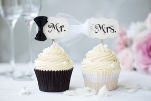 Bride and groom cupcakes for a wedding
