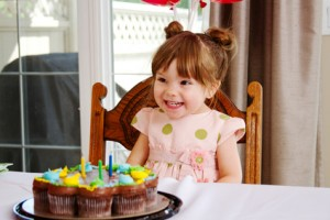 Excited little girl with birthday party